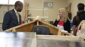 Executive Director Vernon M. Billy and President Cindy Marks learn about the boat being constructed by Sacramento City Unified engineering students.